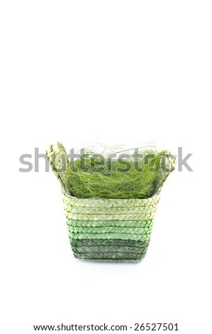 Easter basket with grass isolated on white.Place for text