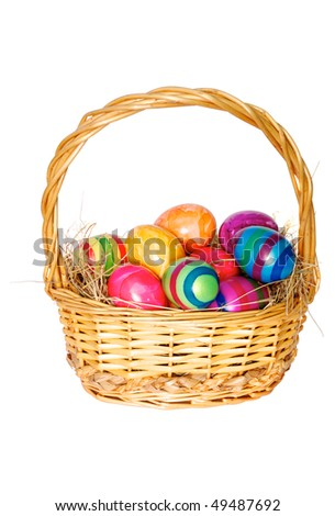 Easter basket with painted eggs on white background - stock photo