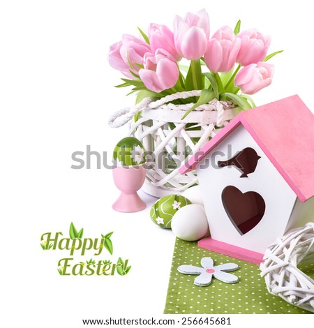 Easter border with pink tulips and matching spring decorations, space for your text - stock photo