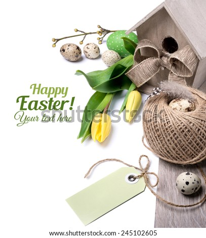Easter border with yellow tulips and natural decorations, space for your text - stock photo
