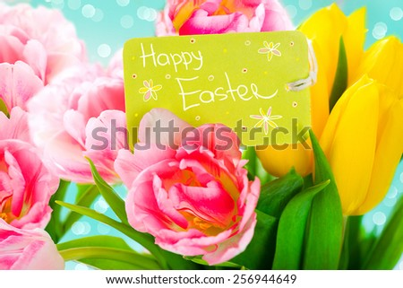 Easter bouquet of spring flowers with greeting card. Spring Flowers bunch. Beautiful colourful Tulips bouquet. Elegant Easter gift. Springtime. Beautiful Easter background - stock photo