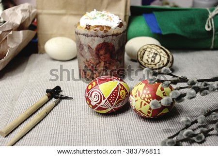 easter bread, wax painted colorful eggs, wooden sticks, buds on branches, springtime, holiday card - stock photo