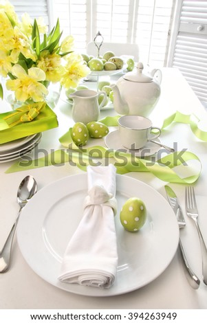 Easter brunch place setting with tulips and eggs