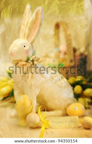 Easter bunny and eggs with a painterly wash effect - stock photo