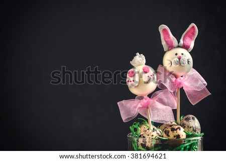 Easter bunny cake pops on dark background with copy space  - stock photo