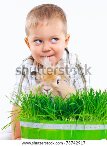 Easter Bunny. Cute boy with a rabbit - stock photo