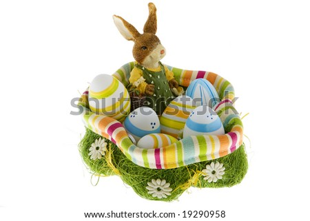 Easter bunny in the nest with eggs