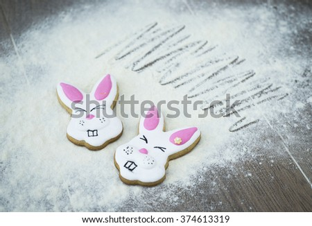 Easter bunny in white flour. Delicious Easter gingerbread.