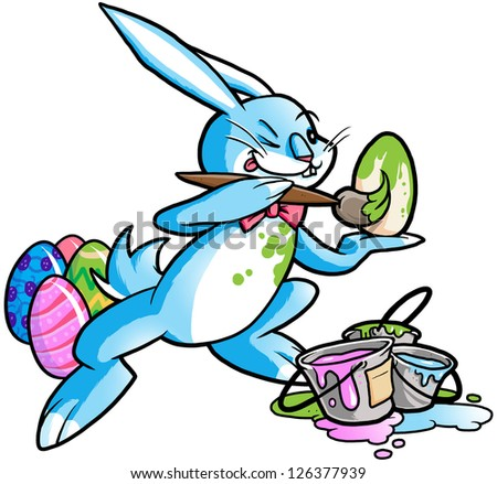Easter bunny painting eggs - stock photo