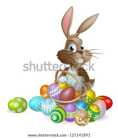 Easter bunny rabbit with Easter basket full of decorated Easter eggs - stock photo