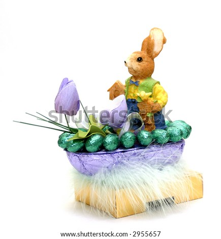 easter bunny with chocolate eggs and flowers  in a basket isolated on white background - stock photo