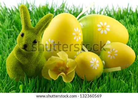 easter bunny with easter eggs on green grass - stock photo