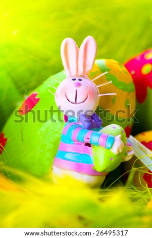 Easter bunny with egg - stock photo