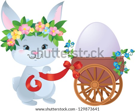 Easter Bunny with egg in a small cart - stock photo