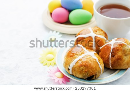 Easter buns with a cross and eggs on a white background. tinting. selective focus - stock photo