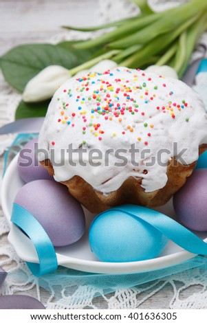 Easter cake and colorful eggs - stock photo