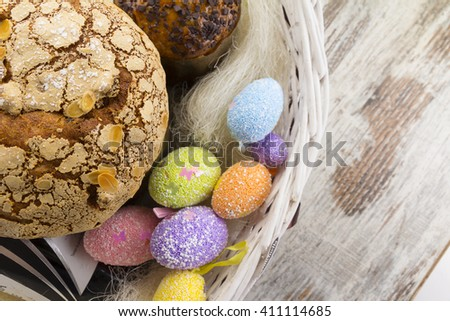 Easter cake and easter eggs over wooden table - stock photo