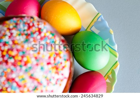Easter cake and painted eggs closeup. Focus on eggs