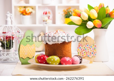 Easter cake with eggs on the table. Easter decorations - stock photo