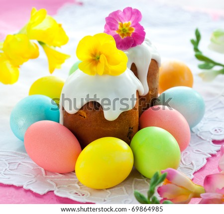 Easter cake with glace icing and colored easter eggs - stock photo