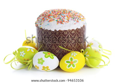 Easter cake with glace icing and easter eggs on white background