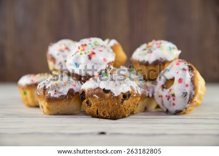 Easter cakes on wood background