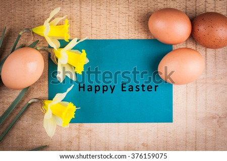 Easter card with an inscription on a wooden background