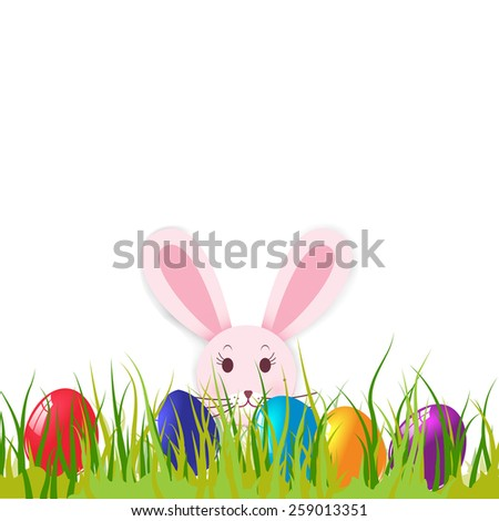 Easter card with eggs and rabbit on green grass. - stock photo