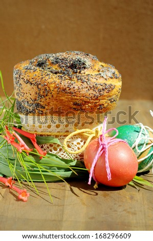 Easter celebration. Decorated poppy seed Kulich and painted eggs.