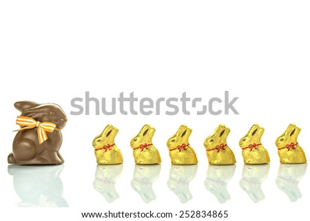 Easter chocolate bunnies lined up on white background - stock photo