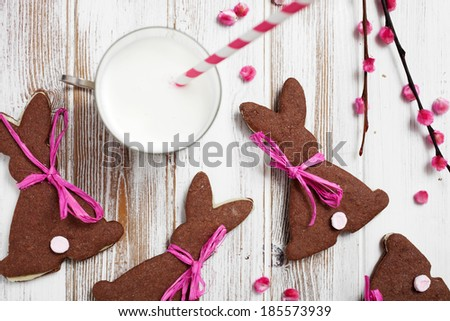Easter chocolate cookies with glass of milk - stock photo