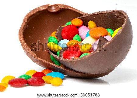 easter chocolate egg and sweets  on a light background - stock photo