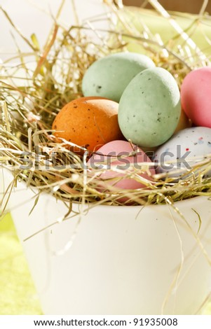 Easter chocolate eggs in the nest - stock photo