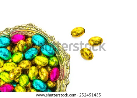 Easter chocolate eggs on white background - stock photo