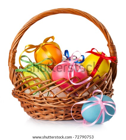 Easter colored eggs in the basket on white background - stock photo