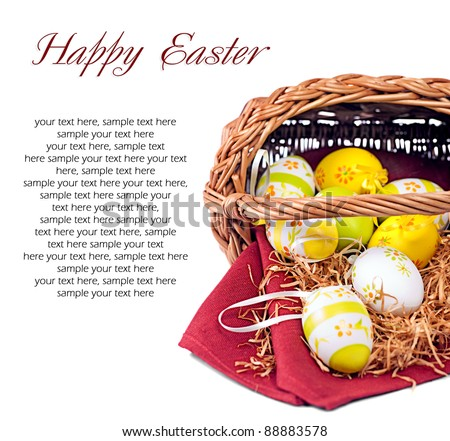 Easter composition: Decorated Easter wicker basket with colorful eggs on red wine napkin (with space for your text) - stock photo