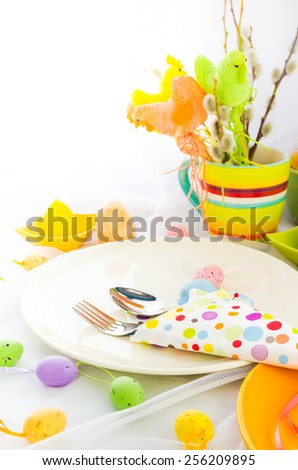 Easter composition table with tableware for one person - stock photo