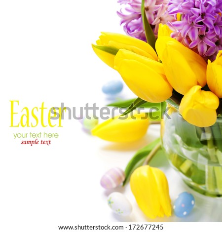 Easter composition with Beautiful tulips in vase over white - stock photo