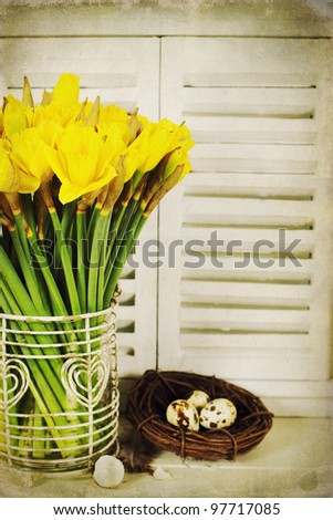 easter composition with eggs and spring flowers