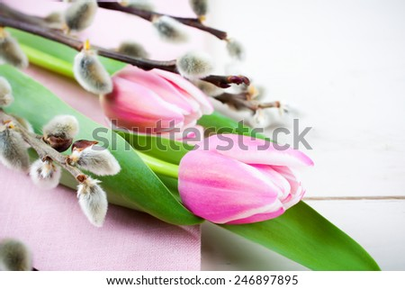 Easter composition with pink tulips on white wooden background - stock photo