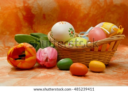 Easter composition with tulips and easter eggs in orange color
