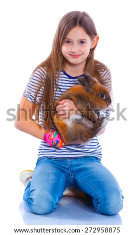 Easter concept image. Portrait of cute girl with adorable rabbit over isolated white background. - stock photo