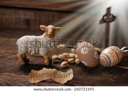 easter concept with cross in light rays and lamb as a symbol of  sacrifice offered to God - stock photo