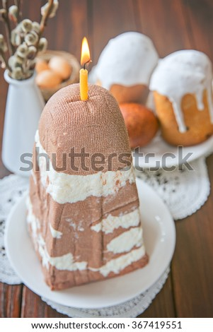 Easter cottage cheese dessert with chocolate (traditional Orthodox Easter dishes) on a wooden background - stock photo