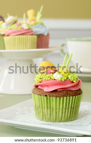 Easter cupcake with sugar decorations - stock photo
