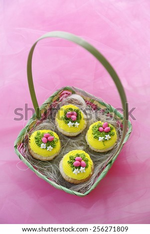 Easter cupcakes. Angel food cupcakes with vanilla icing and candy eggs. - stock photo