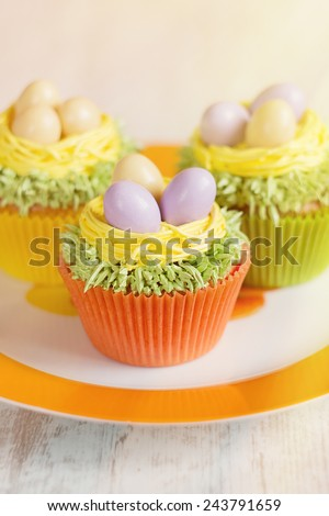 Easter cupcakes decorated with eggs in nest.  Shallow focus. - stock photo