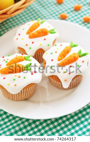 Easter cupcakes, with frosting and decorative carrots - stock photo