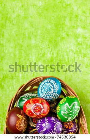 Easter decoration on green background - stock photo