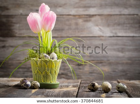 Easter decoration on old wooden background - stock photo